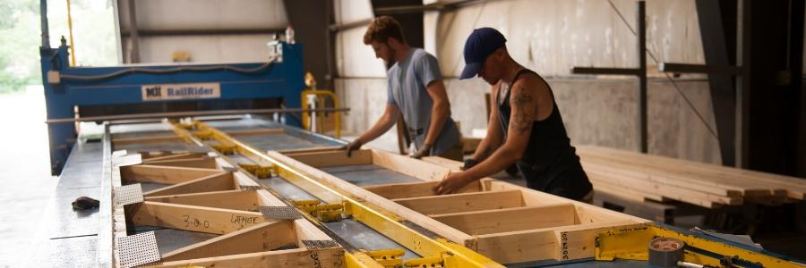 men cutting wall panels